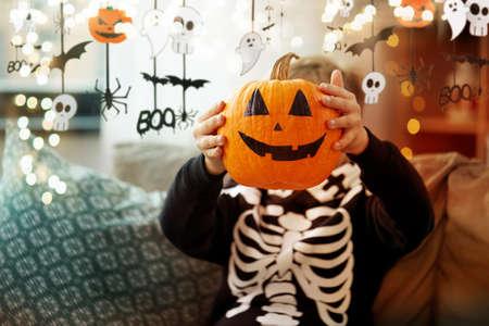boy in halloween costume with jack-o-lantern Zdjęcie Seryjne