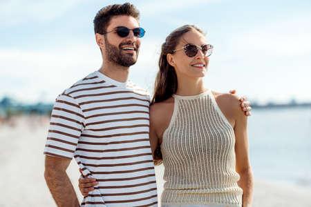 happy couple on summer beach