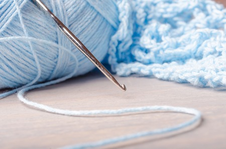 blue cotton yarn and crochet hook.