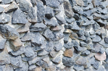 grey rough stone masonry on facade Background Texture
