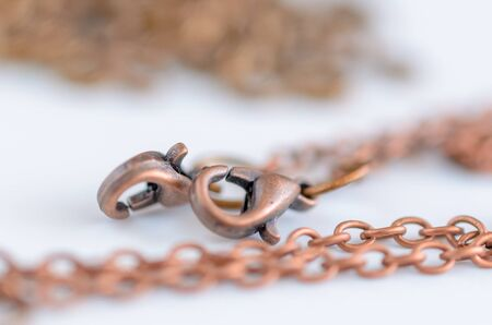Copper chain with lobster clasp for handmade jewelry, craft concept Stock Photo