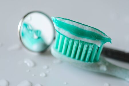 Toothbrush with toothpaste and dental mirror. Oral hygiene health concept