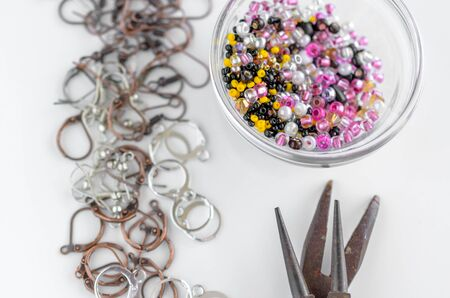 Glass beads, metal findings and tools for jewelry making. Hobby and handmade 免版税图像