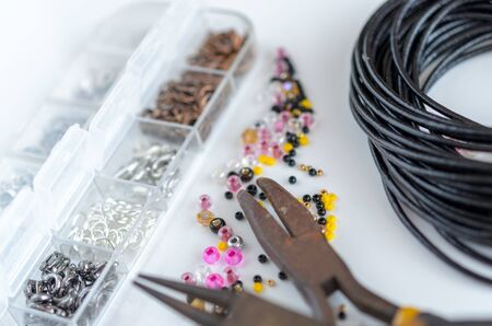 Glass beads, metal findings and tools for jewelry making. Hobby and handmade Stock fotó