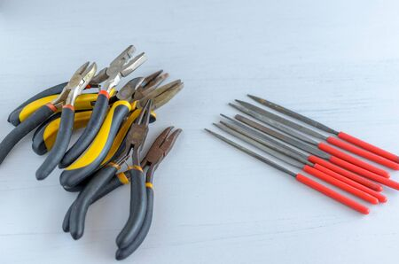Metal jewelry making tools on the table. Creative craft concept 免版税图像