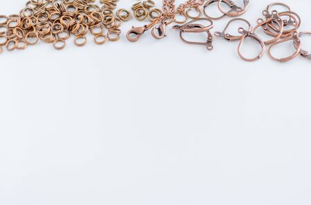 Assorted jewelry making supplies background with space for text