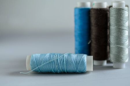 assorted of blue-gray thread spools on table, needlework and tailoring concept Stok Fotoğraf