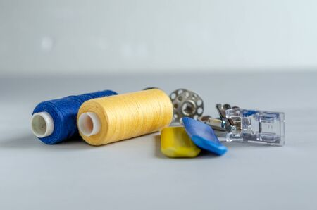 Sewing supplies and needlework accessories blue and yellow colors. Tailoring and craft concept
