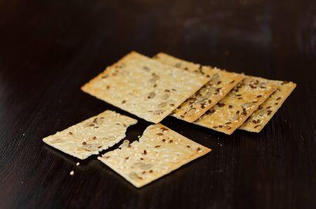 Crunchy multigrain cookies on a dark background. Healthy food concept.