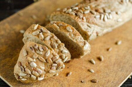 Sliced freshly baked bread on on cutting board. Kitchen utensils, organic food Stock fotó