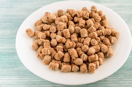 crispy rye bran in the white plate, healthy dieting snack