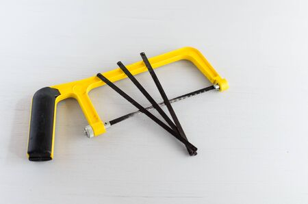 Small hand saw with spare blades for wood and metall.