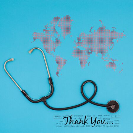 Thanks message worldwide postcard background in different languages for nhs staff, doctors, nurses. Novel coronavirus, covid 2019 thanking note with stethoscope, thank you card with copy space Foto de archivo