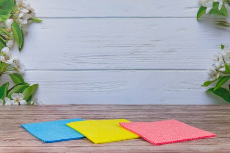 Reusable cleaning cellulose sponges different colours. Absorbent wipes clean kitchen car dish eco-friendly dishcloth hand towel auto. Spring regular cleaning. Flat lay. Empty place for text, logo.