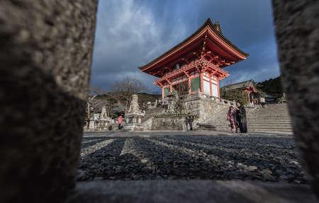 dera: KYOTO, JAPAN - January 08,2015 : Kiyomizu dera Temple Gate in Kyoto Tourists walk near by main gate on January 08,2015