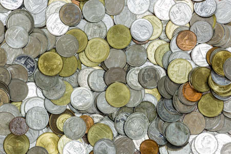 pile of coins: Background of the Huge pile coins mixed color Stock Photo