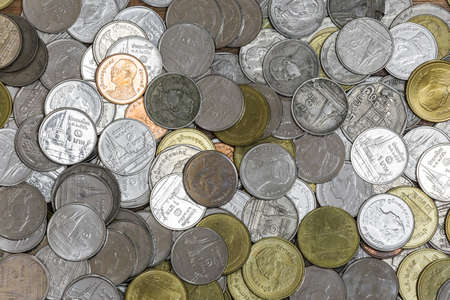 pile of coins: Background of the Huge pile coins of thailand mixed color