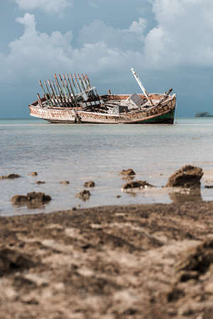 wrecked: Abandoned wrecked ship in seaside Stock Photo