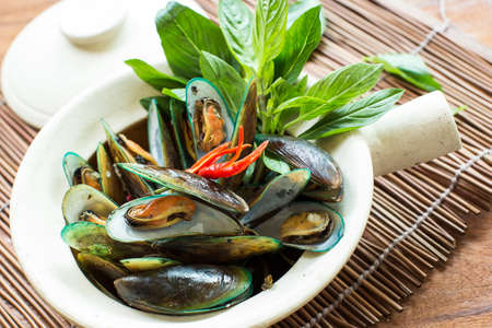 thailand food: Mussels baked with thai spice Stock Photo