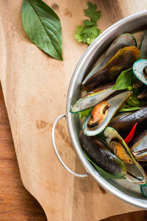 thai herb: Mussels baked with thai spice Stock Photo
