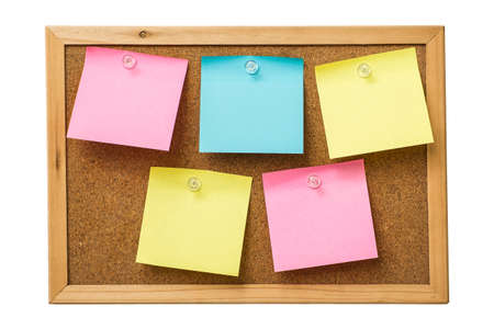 notice of: colorful sticky notes on cork bulletin board Stock Photo