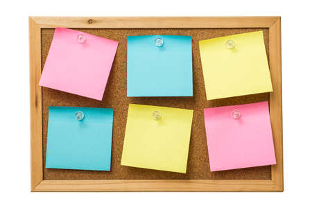 colorful sticky notes on cork bulletin board Stock Photo