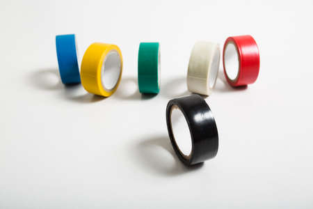 packing tape: selective focus black insulating tape roll isolated on white background Stock Photo