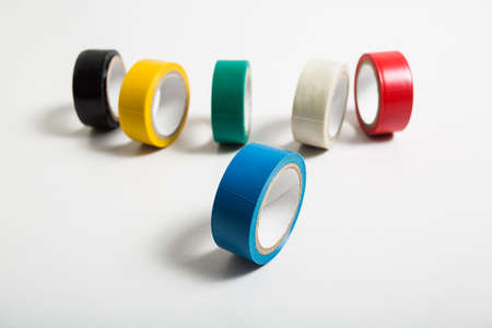 sellotape: selective focus blue insulating tape roll isolated on white background Stock Photo