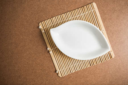 empty bowl: empty bowl on Bamboo  mat Stock Photo