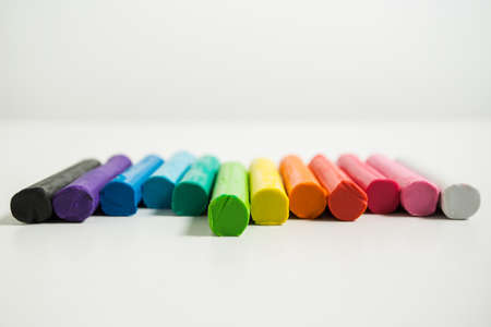 malleable: clay of different colors with white background