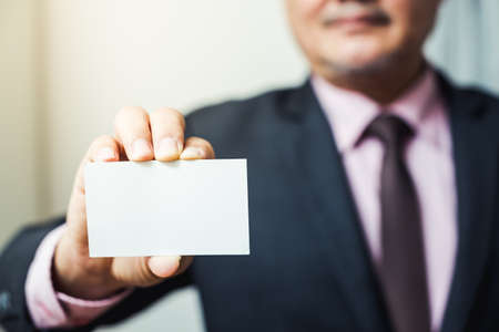 business man give a business card Stock Photo