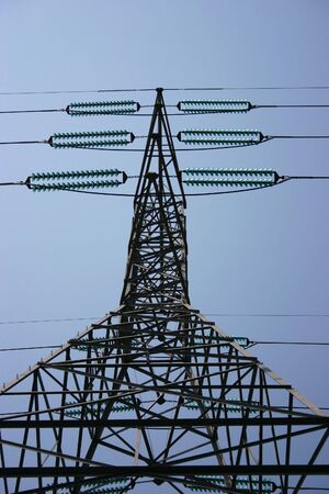 The intricate framework of a tower and wires carrying electricity
