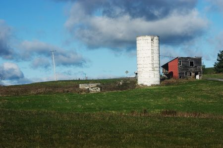 An old abandoned farmhouse and silo in Rensselaerville, New York.  Catskill Mountains.