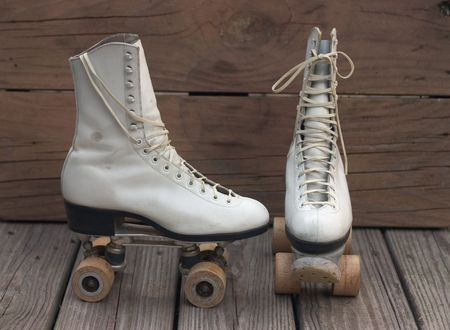 Old roller skates front and side view