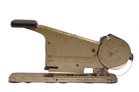 An old antique stapler silo side view