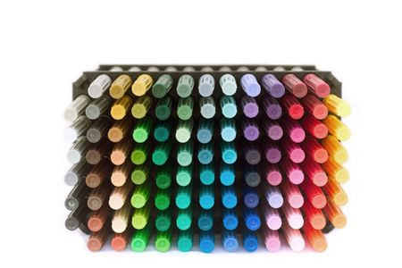 A stack of colorful markers against a white background
