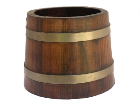 An old wood bucket with brass in silo