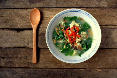 Healthy Soup -Egg soup with vegetables Asian Style on wooden background
