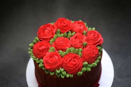 Blur buttercream cake red rose on top for background Stock Photo