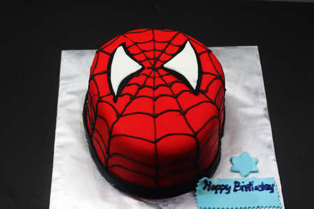 Sabah, Malaysia-March 8 2020 : Spiderman inspired fondant cake art with black background.