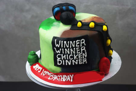 game inspired cake with writing