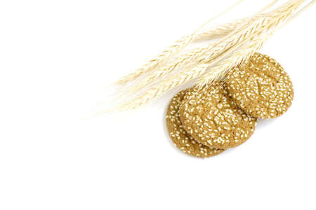 Round oat cookie with ear isolated on white background.. photo