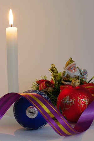 Santa in candles light and christmas ball Stock Photo - 3912803