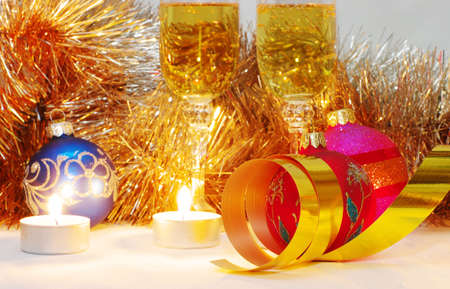 The burning candles, balls and ribbons it are Christmas photo
