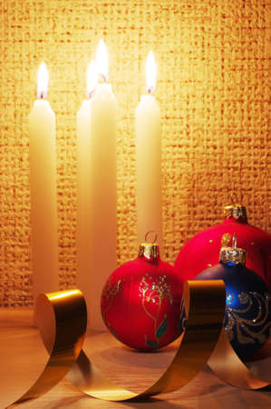 candles, balls and gold ribbons it are Christmas photo