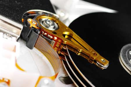 darck: detail of hard disk drive on a darck light