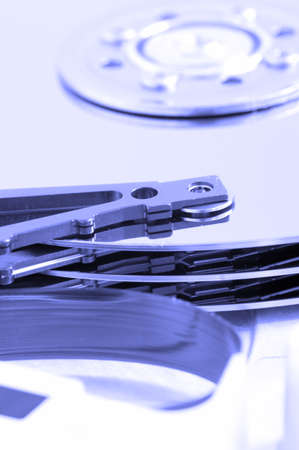 detail of hard disk drive in blue light photo