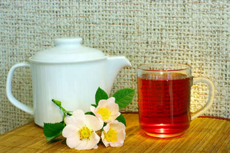 pestil: tea with dog-rose flowers and white teapot