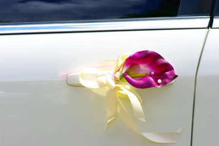 Door of wedding car with flower and pearls photo