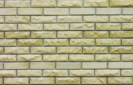Yellow brcik wall background. Brick texture. photo
